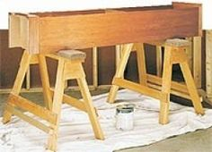 Sawhorses - Homemade sawhorses featuring removable carpet-lined protective pads and plywood support brackets.