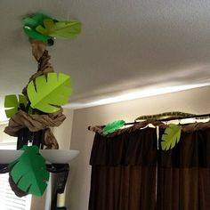 Jungle Vine Decorations: twisted brown packaging paper and construction paper monstera leaves