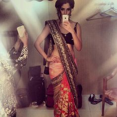 Izabelle leite...love the border of the sari not sure about the pleats area
