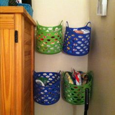 Bins bought from the Dollar Tree and then just held up with thumbtacks. Great space saver to keep things off of the floor! Perfect for a dorm room!