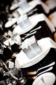 - Black, white and precious silver gift boxes for guests at each setting (psst.don't peek at the Waterford ornament tucked inside) wedding decoration An Elegant Wedding - Celebrate & Decorate Wedding Table, Our Wedding, Dream Wedding, Wedding Reception, Wedding Cakes, White Silver Wedding, Silver Wedding Favors, Elegant Wedding Favors, Wedding Gifts