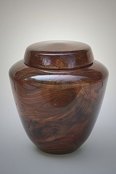 This handcrafted urn is made from black walnut wood. It is one solid piece of wood, plus the lid. The urn is a signed original and one of a kind. It is sealed with an advanced urethane finish, enhancing its durability and preserving the wood. Find it at http://artisurn.com/collections/wooden-urns/products/black-walnut-urn #urn #cremation #handcrafted