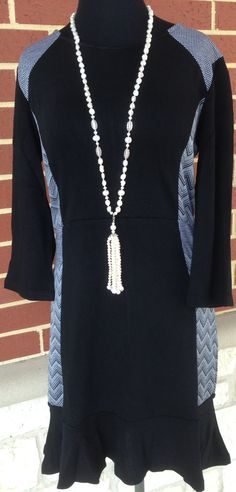 SZ: S-XL $72  DRESSES, DRESSES, DRESSES!!! We LOVE this one!! The gray patterned sides give it that slimming illusion!!! The hemline is slightly flared for a flirty look!!