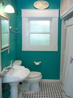 For such a small space, the dark blue-green paint color was too intense for this bathroom.