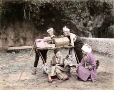1890's. During a break, two kago bearers smoke kiseru pipes while their customer is being served tea by a waitress from a teahouse. The woman's luggage is tied to the roof of the kago. During the Edo Period (1603-1868), only samurai were allowed to ride horses, while horse carriages were unknown. The kago therefore was Japan's main mode of transportation until the invention of the jinrikisha (rickshaw) around 1868.