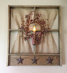 Isnt this window the cutest thing youve seen?! We think so too. Burlap curtains, a pip berry wreath, and a candle make this 20 x 24 wall
