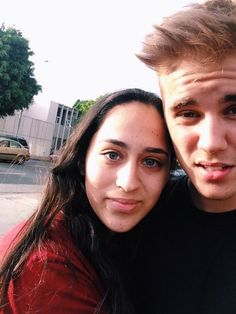 October 14: Another photo of Justin with a fan today in California.