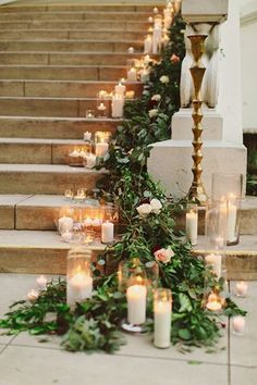 Greenery and candles cascading down the wedding stairs