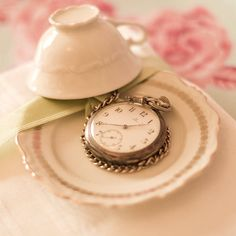 Silver pocket watch.  I have always loved pocket watches, this setting is so pretty, too!
