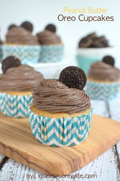 Peanut Butter Oreo Cupcakes - homemade peanut butter cupcakes with a hidden Oreo cookie and fluffy chocolate frosting