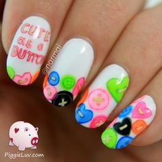 Cute as a Button ~ using glow in the dark polishes by Parrot Polish 'Glow Hot Lips', 'Glow Mr. Yuk', 'Glow Blaze' & 'Linckia' and Serum No. 5 'Lights Out' & 'Awesome Blossom' for the buttons with acrylic paint for the outlines and details ~ by PiggieLuv