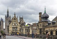 Ghent in Belgium,  It is the Saint Michel bridge with the tower of the Cathedral of Saint Bavon. The clock tower, is the tower of Beffroi de Gand, symbol of Ghent's independence granted in 1180