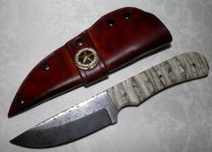 Custom Damascus Steel Knife with Fossilized Mammoth Tooth Handle and Leather Sheath
