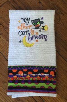 """Fun Halloween Embroidered Bar Towel has the saying """"My other car is a broom"""" embroidered across the middle and halloween fabric sewn all the way across the bottom of the towel. Would look great hangin"""