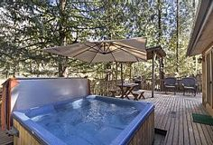 5 person hot tub; covered BBQ area dinning table and rockers to enjoy