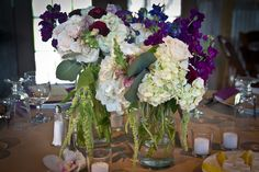 Cluster centerpiece with white, green and plum floral
