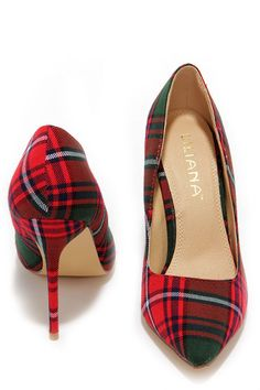 "From Highlands to high rises, the Who's Plaid! Red Plaid Pumps are sweeping the globe with their good looks! These cuties feature a red, green, white, and navy plaid fabric upper with a pointed toe. Wrapped stiletto heel measures 4"" tall. Cushioned insole. Felted rubber sole has nonskid markings. Available in whole and half sizes. Measurements are for a size 6. All vegan friendly, man made materials."