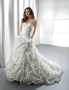 Fabric: Organza  Neckline: Strapless  Silhouette: Fit N' Flare  Features: Asymmetrical Ruching and Crystal Jeweling on Bodice, Corset Back, Scrolls/Pickups/Flowers on Skirt, Attached Train