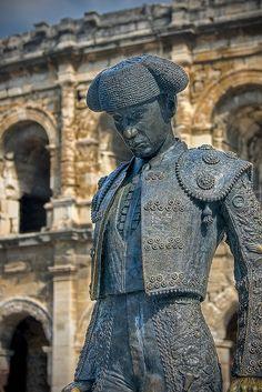 A matador statue outside of the Roman Colosseum in Nîmes, France.