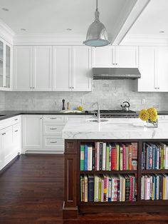 Black + White = A Timeless Classic - High-End Kitchen Countertop Choices on HGTV I like the idea of black lower cabinets & white uppers.