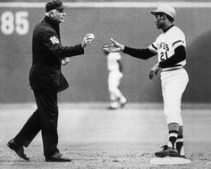 Roberto Clemente receives the ball from Doug Harvey after his 3000th, and final, career hit.