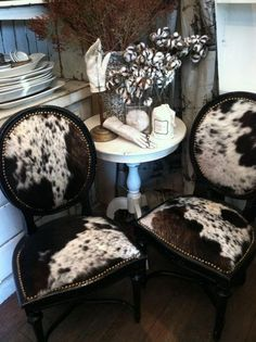 These cowhide chairs would look great at the cabin.