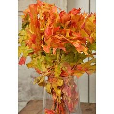 Bring the beautiful colors of fall inside with preserved harvest tone oak leaves! The leaves are preserved on the branches making them perfect to add to arrangements, tablescapes and wreaths. Order today for your Autumn, harvest, and Thanksgiving decor. DriedDecor.com #tablescapes #tablesetting #homedecor #fallwedding #falldecor #farmhouse #driedflowers #oakleaves #driedplants #autumndecor #autumn #thanksgiving
