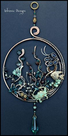 """Underworld"" Multi gemstone, wirewrapped suncatcher by Cathy Heery from Intrinsic Designs"