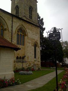 "Buckinghamshire's ""Best Kept Town"" sign, outside St Mary & St Giles Church"