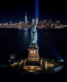 No day shall erase you from the memory of time - Virgil. ( credit: @brandontaoka) . . . #weremember #911 #worldtradecenter #manhattan #statueofliberty #nyc #newyork #nypd #nyfd #empathy #peace #love #memorial #tribute #beautiful #skyline #newyorkcity