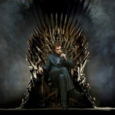 Dexter Morgan sitting on the Iron Throne... sword throne from Game of Thrones.