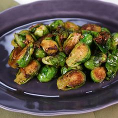 2 Shallots, 3 Garlic cloves, 1-2 Anchovy Fillets, 2 pounds Brussels Sprouts (trimmed and halved) Black Pepper, Turbinado Sugar (optional)