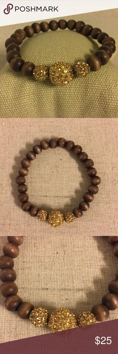 Stella and Dot Prosper Bracelet Very pretty stretch bracelet with wooden beads surrounding gold pave and topaz crystal beads. It is a retired design. It is adjustable so it fits most wrists. It was never worn and only used as a sample. NWOT. Stella & Dot Jewelry Bracelets