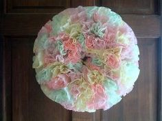 Use coffee filters & food coloring to create this pretty #wreath for spring!
