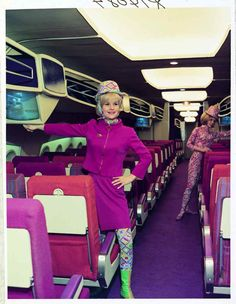 A 'Braniff Babe' models a 1966 Pucci-designed uniform on a full-size model of the Boeing SST.