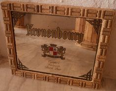 A fabulous, sturdy mirror that would be perfect in a bar, taverna or restaurant, over a fireplace or in your home. An old Kronenbourg beer mirror has been upcycled to make this piece, the mirror has been framed and surrounded by wine corks.  The overall effect is pretty dramatic.  The mirror, being an old mirror, has an antiqued effect due to mirror spots, which actually adds to the overall effect.