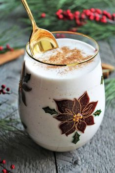 This spoon up eggless eggnog is so thick, rich, and creamy, you eat it with a spoon! Alcohol free or spiked with rum, this vegan eggnog is a holiday treat that will be the hit of your holiday party! Made with aquafaba and your choice of plant-based milk like soy or almond, this fluffy vegan eggnog is sure to be a new Christmas favorite! #veganeggnog #veganchristmas #thehiddenveggies.