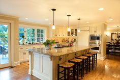 Traditional Kitchen traditional kitchen | L -shaped kitchen, large island, windows
