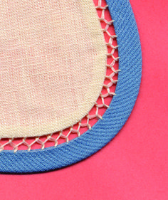 Add color, contrast, dimension and intricate detail to the edge of a Peter Pan collar. A narrow bias tube is connected to the faced edge of the collar with fagoting. The number of fabric, color & thread combinations with this technique is endless! Made by Trudy Horne