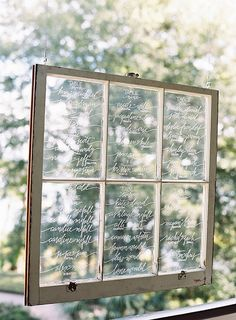 Lowcountry Paper Co. created the most gorgeous window pane seating chart with handwritten calligraphy for Whitney & Vince's elegant reception. Photo: Virgil Bunao / Event Planning & Design: Ashley Rhodes Event Design   Snippet & Ink
