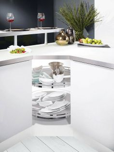 Pull-out trash bins are a better solution than having to open a cabinet door and close it back every time, if your trash bin is placed inside. Hide the unsightly and unhealthy trash bins so that they will still be accessible and functional. www.floatproject.org Smart Kitchen, Red Kitchen, Compact Kitchen, Placard D'angle, Cabinet Drawers, Cabinet Doors, Dining Room Design, Kitchen Design, Corner Cupboard