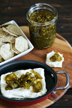 Candied Jalapenos on cream cheese and crackers from foodiewithfamily.com