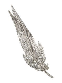 Diamond and platinum feather brooch by Sterle. Christie's
