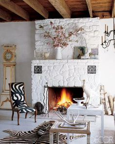 painted fieldstone fireplace and Danish chair upholstered in vintage marimekko fabric