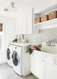 Laundry room Featuring custom white cabinets and an utility sink, this laundry room is not only beautiful but also very practical. The cabinet and wall color is Cool December by Dunn Edwards Laundry room Laundry room White Laundry Rooms, Laundry Room Shelves, Laundry Room Layouts, Laundry Cabinets, Laundry Room Remodel, Laundry Decor, Farmhouse Laundry Room, Laundry Room Organization, Farmhouse Style