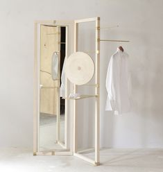 Vienna design duo chmara.rosinke created this wooden vanity stand for a local shirt tailor (+ slideshow).