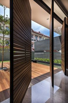 Wood slatted doors that center-pivot to open. :-)   Mimosa Road by Park + Associates