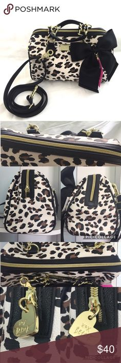 Betsey Johnson Medium Speedy Animal Print Purse 🌷NWT/New with defect 🌷Flaws are shown on pics.Some small spots/scratch on hardware & some fuzziness on handbag(probably something stuck to it from being stored with other items)Not noticeable when wearing 🌷No wear inside or out. 🌷Long strap is adjustable 🌷Pet Friendly/Smoke free home 🌸🌸Feel free to Make and Offer🌸🌸 ✨I do my best to inspect and describe every detail and every flaw (if there's any present) on all my items.No details are…