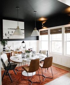 Emily Henderson dining room - dark walls, holiday decoration but modern