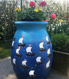 DIY Ombre effect rain barrel with little sail boats.